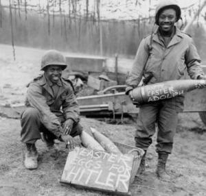 Cpl. William E. Thomas and Pfc. Joseph Jackson prepare a surprise for German troops on Easter morning, 1945.Photo courtesy of the National Archives