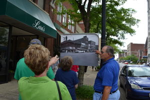 Early crowds were abundant for the first few hours of this year's annual Downtown Ashland Historic Walking Tour. Sudden storms damaged roughly half of the otherwise weatherproof enlargements of vintage photos taken during the 1940s. File photo by Mike James, The Independent